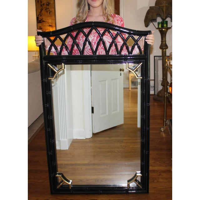 This is a vintage Thomasville Allegro faux bamboo mirror thats's been professionally lacquered in black with gold on the...