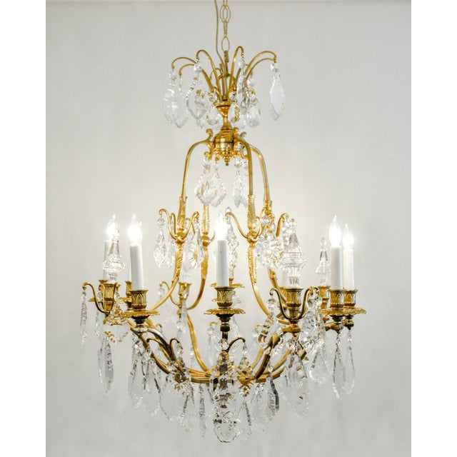 Antique French cut crystal eight arms brass frame chandelier. Excellent working condition, rewired for US use. The...
