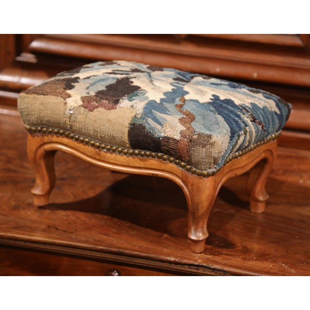 This elegant, antique footstool was crafted in Lyon, France, circa 1860. The carved, rectangular footrest has been...