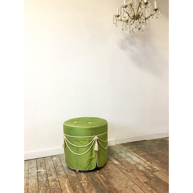 A fantastic vintage Hollywood Regency footstool in luscious green silk with cream buttons and tassels. This would be...