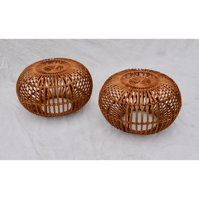 Pair of 1950's rattan ottomans by Franco Albini . Large scale body design allows for nice side table as well as ottoman...