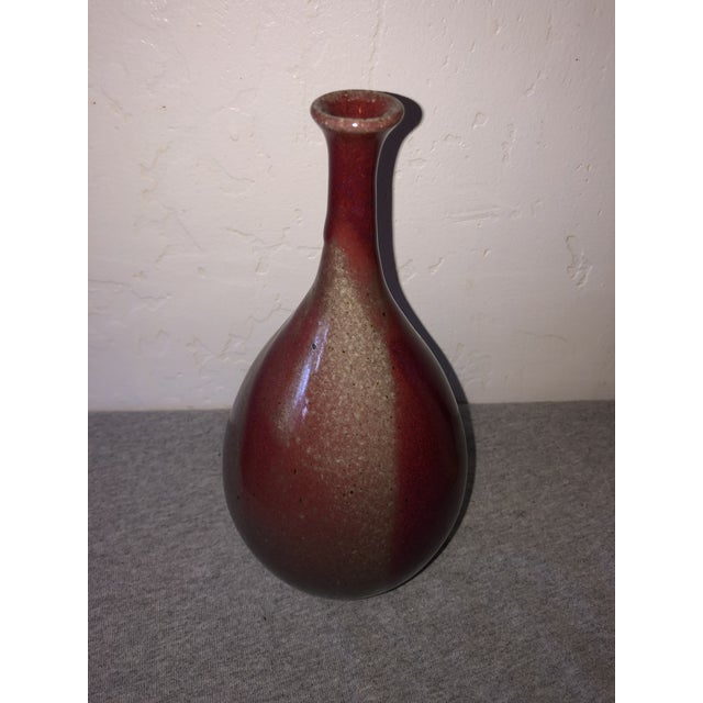 Modernist weed pot or bud vase with striking two tone glaze.