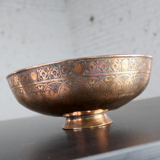 Beautiful antique Turkish copper footed bowl. It is hand forged and hand chiseled with a gorgeous allover design. It is in...
