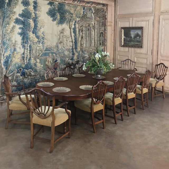Set of 12 Antique English Sheraton Dining Chairs includes 4 Armchairs and were hand-crafted from fine walnut, and feature...