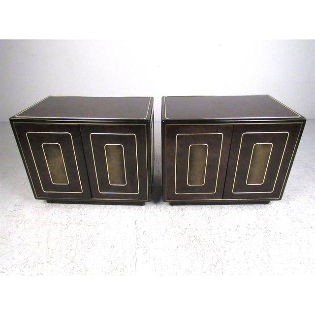 This stunning pair of vintage nightstands feature burl walnut and acid-etched brass. Spacious shelved cabinet space allows...