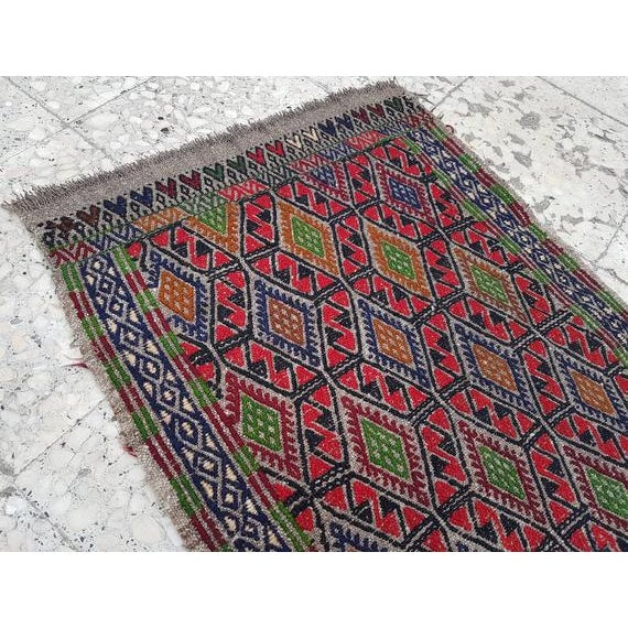 This is a vintage Turkish rug from the 1970s. Handwoven with high quality wool.