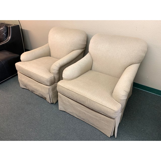 Design Plus Gallery presents a Pair of Baker English Rolled Arm Chairs. Upholstered in a heathered neutral chenille blend....