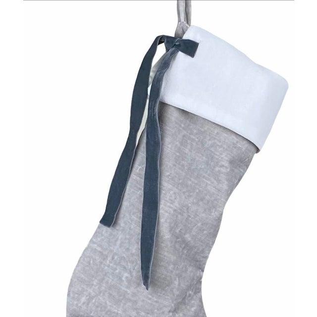 Custom silver French velvet stocking with removable white velvet collar and double-faced Swiss velvet ribbon tie. The...