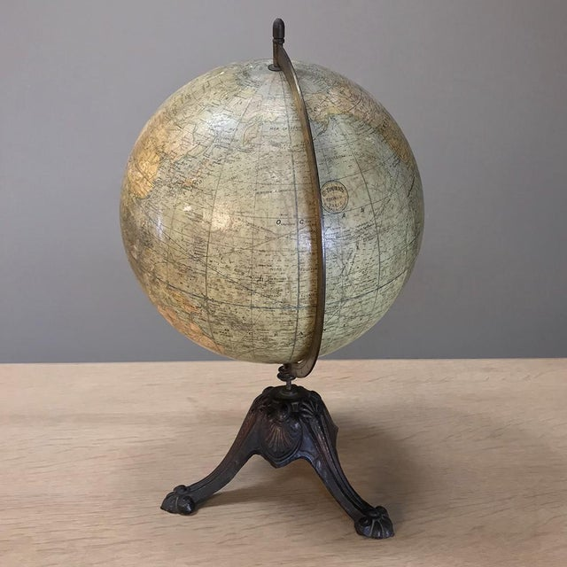 Antique French Paper Mache' World Globe on Painted Cast Iron Stand. Antique French papier mâché' World Globe on cast iron...