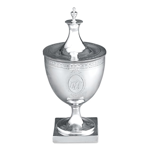 A unique piece in the great Hester Bateman's oeuvre, this covered Georgian silver sugar bowl takes the form of an urn. The...