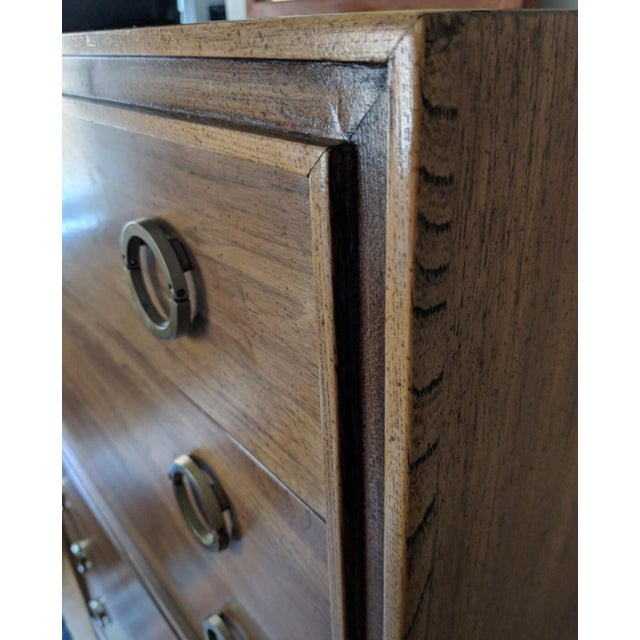 This highboy dresser by Hickory Manufacturing Co features the original brass hardware which is amazing. This is a quality...