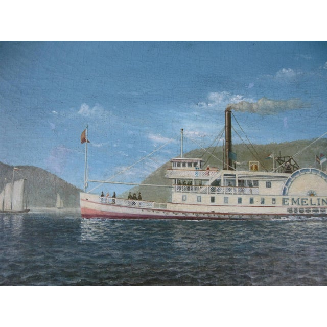 A very well done oil on canvas painting of a paddle steamer on the Hudson river done by noted artist Albert Nemethy....