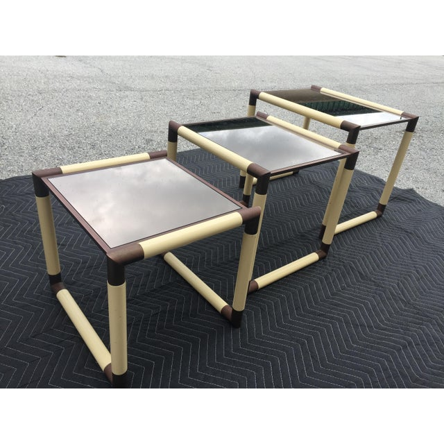 Fantastic cube form glass top tables. Brass corners pieces connect 1 inch thick tubular segments simulating parchment. The...