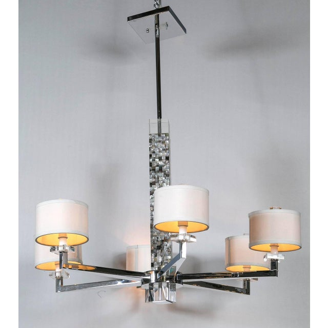 The seller says: A Mother of Pearl micro-mosaic decorated chandelier. The chrome six-lighted fixture having circular...
