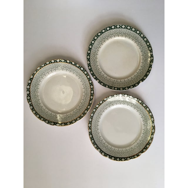 This set of 3 salad sides plates have a gold trimmed scallop edge & lovely green intricate detailing. There is significant...