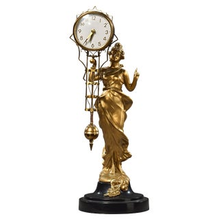 1930's Gilded Fancy Lady Swinging Clock For Sale