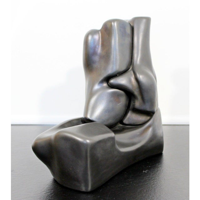 For your consideration is a lovely abstract table sculpture, reminiscent of entwined bodies, signed F. Calderon, dated...