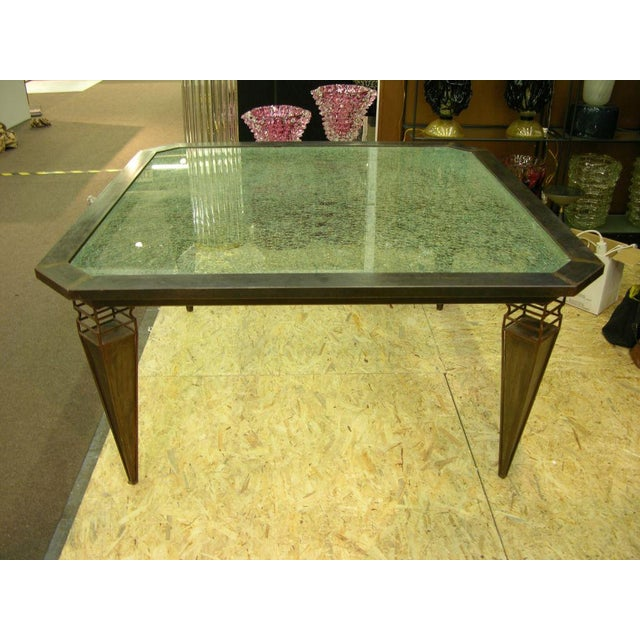 1980s handcrafted Italian iron table, custom-made, with a stunning rustic look and superb design for the open legs. The...