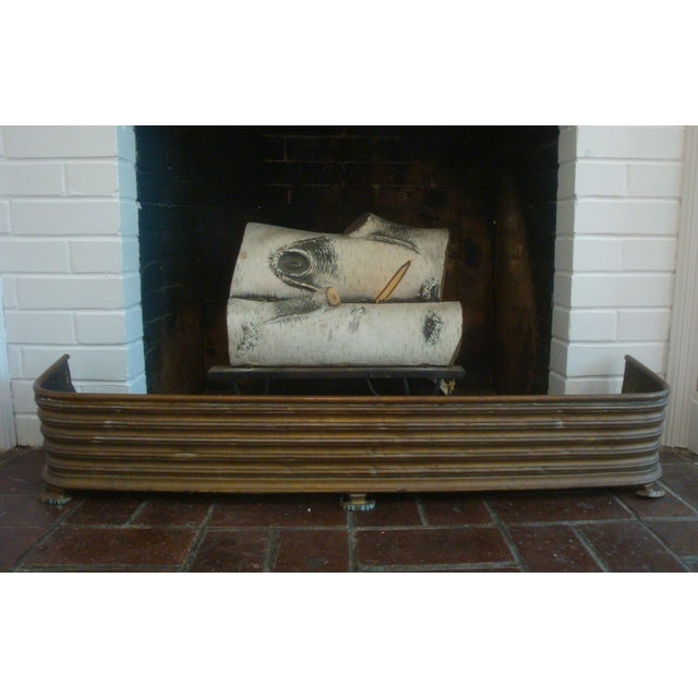 Very unusual brass metal fireplace fender from the Arts and Crafts era, dating to early 20th C. Note the richly ribbed...