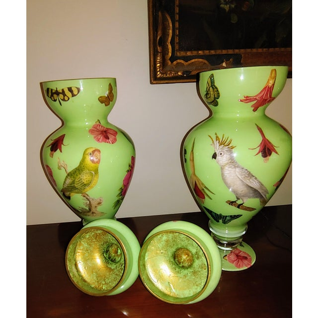 Two Glass painted urns with tops circa 1980. On the bottom there is a Twigs and Moss label and signed by the artist...