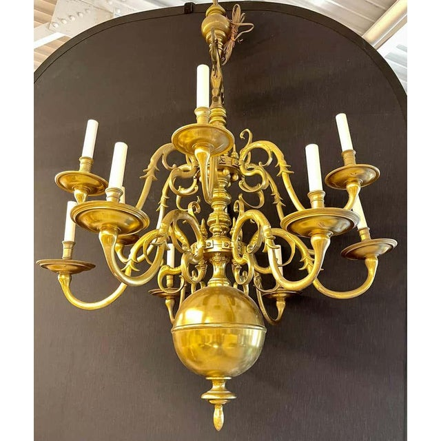 English Georgian style bronze chandelier having a pair of rare winged eagles on top of the many scrolled and lighted arms...