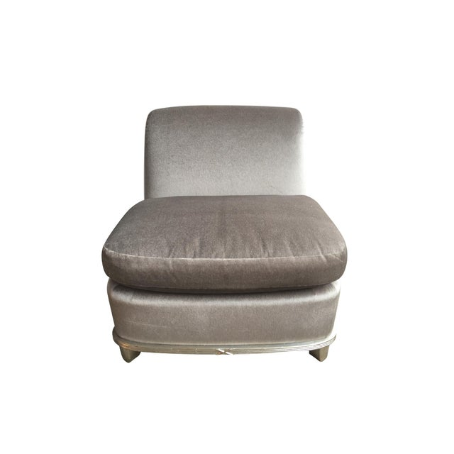 This stunning lounge or slipper chair was made in the 1960s. It was recently reupholstered in a silver mohair, which...