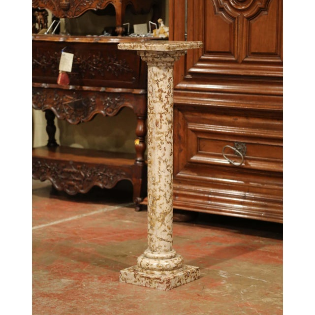 This elegant antique marble pedestal was crafted in France, circa 1880. The colorful pedestal built in three sections,...