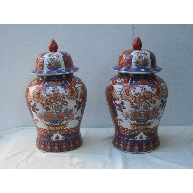 Large pair of Imari style Chinese jars with lids.