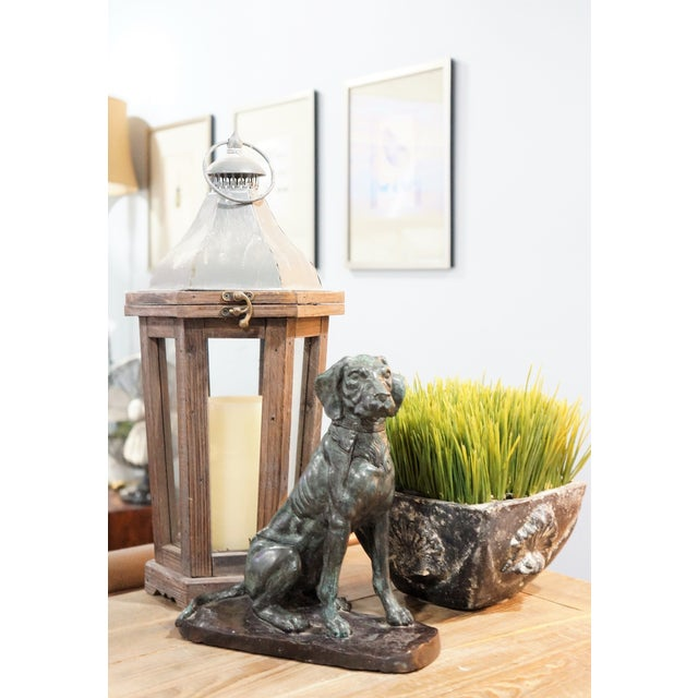 A vintage bronze sculpture of a sporting dog. The dog is finely cast with superb detail, setting, intent and waiting for...