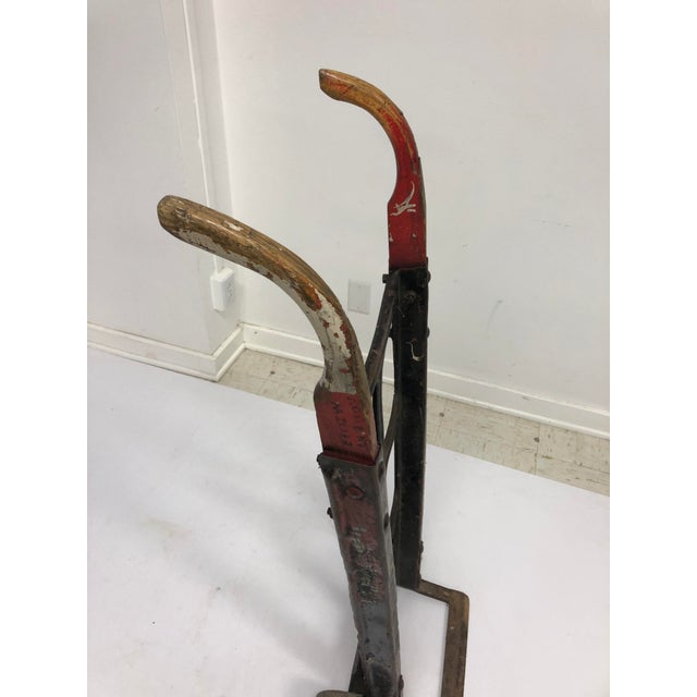 Vintage Steel Dolly. Removed from a factory in Lebanon PA. Will sit flat as shown or stand on its own. Neat and red and...