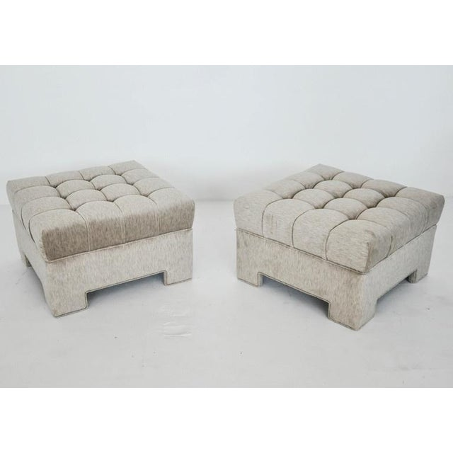 Pair of tufted stools by Milo Baughman. Newly upholstered in velvet.