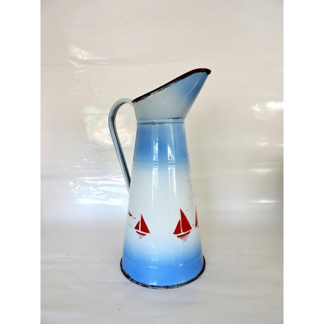 Originally bought in Marseille, France in the 70's, a large blue and white vintage metal pitcher with stencilled red...