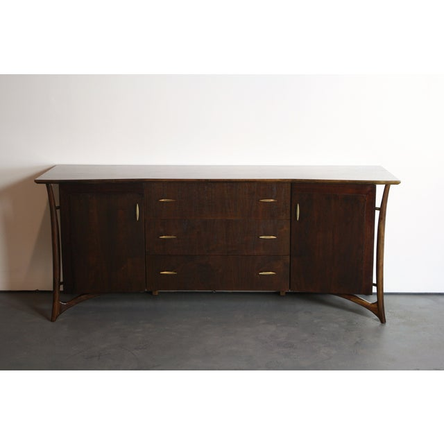 In my time collecting MCM pieces, I have only seen two of these dressers/credenzas from this Daniel Jones series come...
