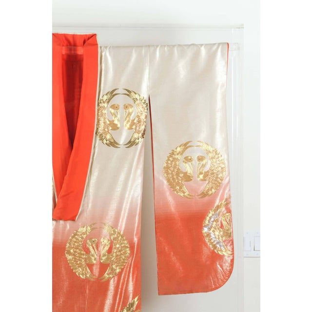 A vintage Japanese ceremonial kimono, circa 1940-1950, beautifully framed and displayed in a Lucite shadow box. An...
