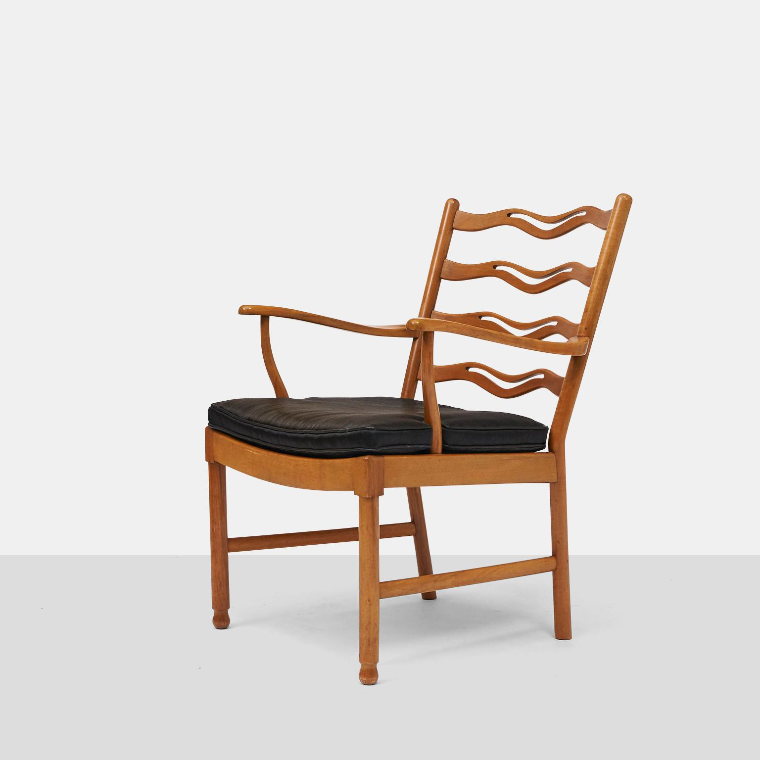 A Lounge Chair In Bleached Mahogany With A Black Leather Seat. Made For  Fritz Hansen