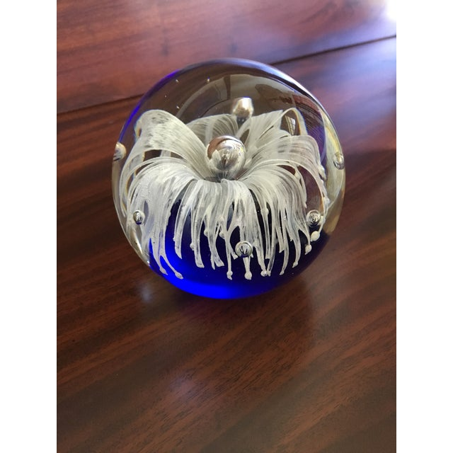 Beautiful fringed flower formed from molten glass with a perfect air bubble forming the center. The flower appears to be...