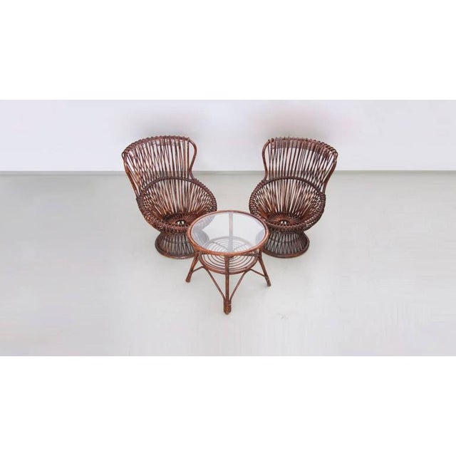 Rare set of two armchairs with rattan frame by Franco Albini for Vittorio Bonacina. Small round table available with glass...