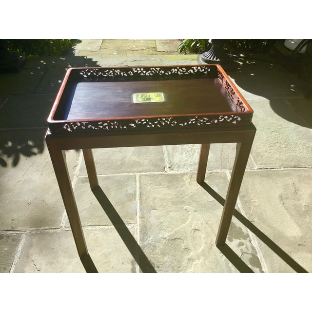 Beautifully constructed Chinoiserie tray table. Tray is artfully constructed of rosewood with a fretwork edge. The base is...
