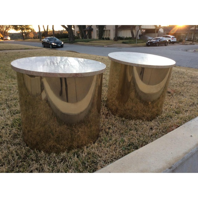 A matched pair of Italian Travertine top aluminum cylinder drum tables with a brass finish. By Paul Mayen for Habitat...