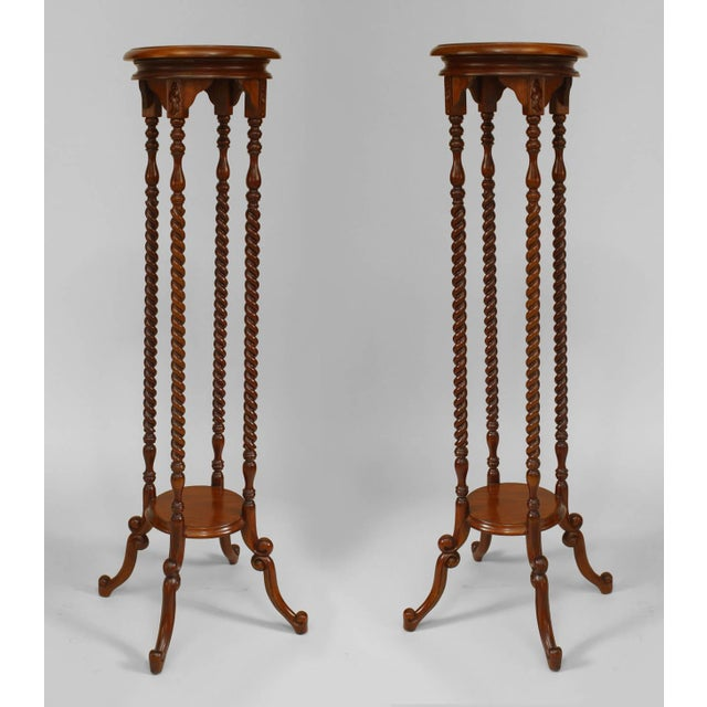 Pair of English pedestals with four swirl design columns and a bottom shelf.