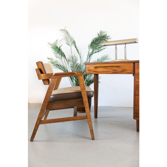 Features vintage striped upholstery and vinyl trim on a sturdy solid walnut frame with floating walnut backrest. Slanted...