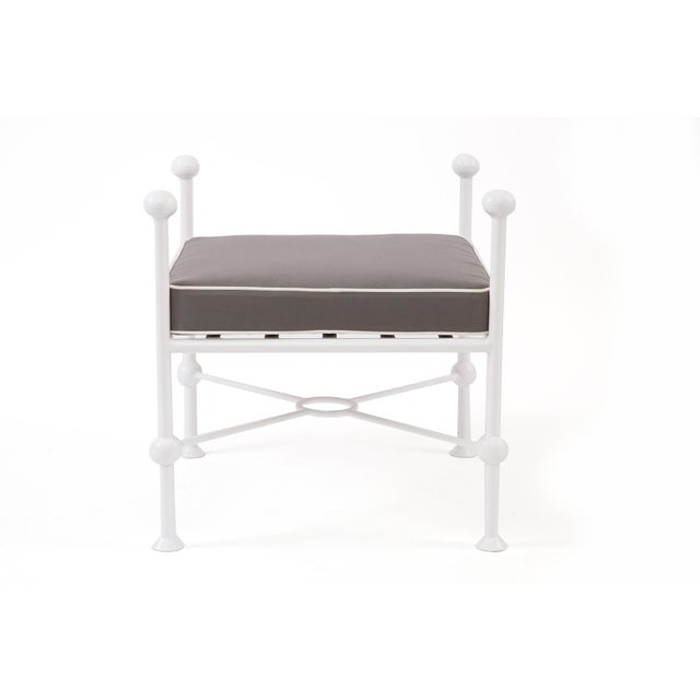 Pair of powder coated iron and upholstered ottomans, circa late 1970s. These examples have been newly powder coated and...