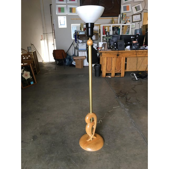 Heifetz style Mid-Century hand-carved abstract wood torchiere floor lamp pair with milk glass shades and brass accents.