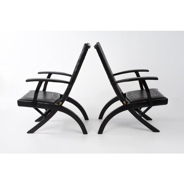 Extremely rare set of two Mid-Century Modern tall back folding arm chairs designed by Angel I. Pazmino in the 1970s for...