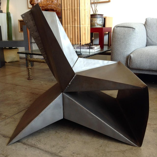 Utterly unique, folded steel-construction statement chair.