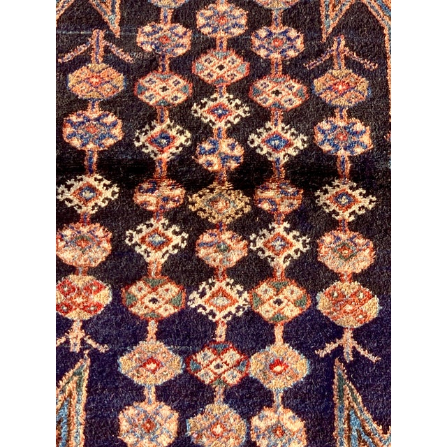 This is a vintage Persian Mazlaghan rug. The piece was made in the 1930s.