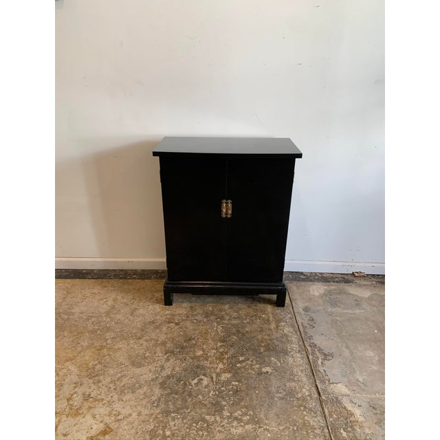 We fancy this handsome slim black cabinet as an elegant entry table for small spaces but, it would equally suit as a...