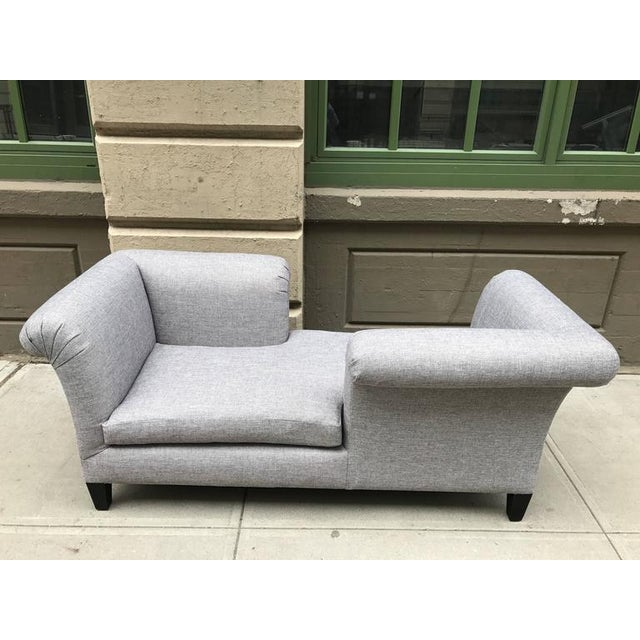 Flavor custom design Tete-a-Tete. Upholstered gray linen-blend material. Has a down seat and black lacquered legs. COM...