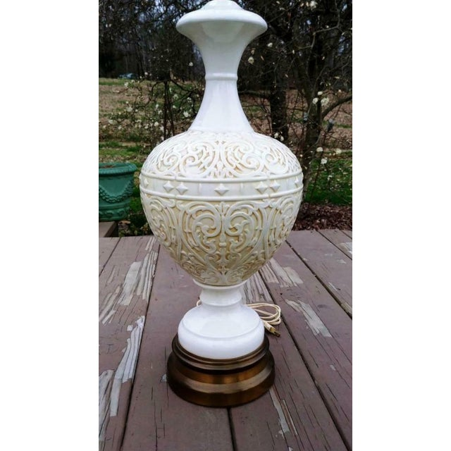 Item offered is a a nice large Italian style embossed white pottery lamp on a brass base. It is a nice quality lamp. The...