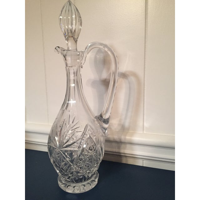 Time to serve wine to your dinner party in this beautiful crystal decanter!